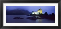 Framed Castle lit up at dusk, Eilean Donan Castle, Loch Duich, Dornie, Highlands Region, Scotland