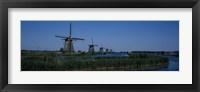 Framed Traditional windmills at a riverbank, Kinderdijk, Rotterdam, Netherlands