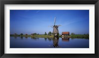 Framed Reflection of a traditional windmill in a lake, Netherlands