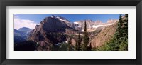 Framed Trees with a mountain range in the background, US Glacier National Park, Montana, USA