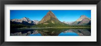 Framed Reflection of mountains in Swiftcurrent Lake, Many Glacier, US Glacier National Park, Montana, USA