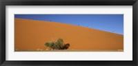 Framed Tourists climbing up a sand dune, Dune 45, Sossusvlei, Namib Desert, Namibia