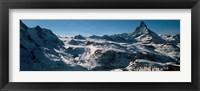 Framed Skiers on mountains in winter, Matterhorn, Switzerland