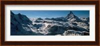 Framed Skiers on mountains in winter, Matterhorn, Switzerland