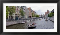 Framed Tourboats in a canal, Amsterdam, Netherlands