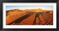 Framed Shadows of camel riders in the desert at sunset, Sahara Desert, Morocco