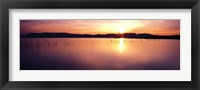Framed Reflection of sun on water at dawn, Elephant Butte Lake, New Mexico, USA