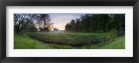 Framed Green field with university building in the background, King's College, Cambridge, Cambridgeshire, England