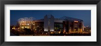 Framed Football stadium lit up at night, Old Trafford, Greater Manchester, England