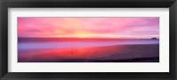 Framed Sunset light painting waves across sandy shore on beach, Laguna Beach, California, USA