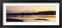 Framed Forggensee Lake and Allgau Alps at sunrise, Ostallgau, Bavaria, Germany