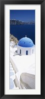 Framed High angle view of a church with blue dome, Oia, Santorini, Cyclades Islands, Greece