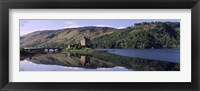Framed Eilean Donan Castle with reflection in the water, Highlands Region, Scotland