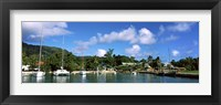 Framed Yachts and small fishing boats at the harbor on La Digue Island, Seychelles