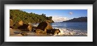 Framed Waves splashing onto rocks on North Island with Silhouette Island in the background, Seychelles