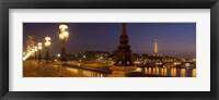Framed Bridge across the river lit up at dusk, Pont Alexandre III, Seine River, Paris, Ile-De-France, France