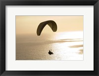 Framed Silhouette of a paraglider flying over an ocean, Pacific Ocean, San Diego, California, USA