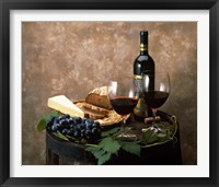Framed Still life of wine bottle, wine glasses, cheese and purple grapes on top of barrel
