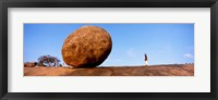 Framed Low angle view of a sacred rock, Krishna's Butterball, Mahabalipuram, Tamil Nadu, India
