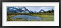 Framed Lake with mountains in the background, US Glacier National Park, Montana, USA