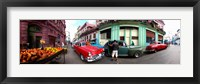 Framed 360 degree view of old cars and fruit stand on a street, Havana, Cuba