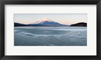 Framed Yamanaka Lake covered with ice and Mt Fuji in the background, Yamanakako, Yamanashi Prefecture, Japan
