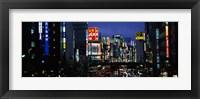 Framed Buildings lit up at night, Shinjuku Ward, Tokyo Prefecture, Kanto Region, Japan
