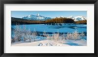 Framed Frozen river with mountain range in the background, Mt Fryatt, Athabaska River, Jasper National Park, Alberta, Canada