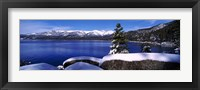 Framed Lake with a snowcapped mountain range in the background, Sand Harbor, Lake Tahoe, California, USA