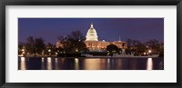 Framed Government building lit up at dusk, Capitol Building, National Mall, Washington DC, USA