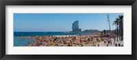 Framed Tourists on the beach with W Barcelona hotel in the background, Barceloneta Beach, Barcelona, Catalonia, Spain
