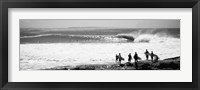 Framed Silhouette of surfers standing on the beach, Australia (black and white)