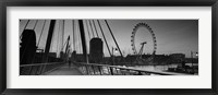 Framed Bridge across a river with a ferris wheel, Golden Jubilee Bridge, Thames River, Millennium Wheel, London, England