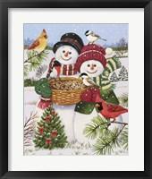 Framed Snow Couple Feeding Birds