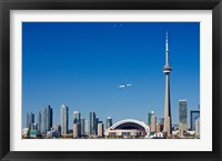 Framed Airplane over city skylines, CN Tower, Toronto, Ontario, Canada 2011