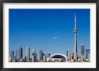 Framed Airplane over city skylines, CN Tower, Toronto, Ontario, Canada 2011