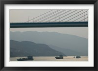 Framed Container ships passing a newly constructed bridge on the Yangtze River, Wanzhou, Chongqing Province, China