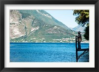 Framed Man Fishing from Dock on Edge of Lake Como, Varenna, Lombardy, Italy