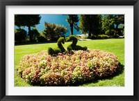 Framed Topiary and flower bed in a garden, Villa Carlotta, Tremezzo, Como, Lombardy, Italy