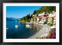 Framed Houses at waterfront with boats on Lake Como, Varenna, Lombardy, Italy