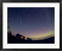 Framed Circumpolar star trails with a faint aurora over horizon, Alberta, Canada