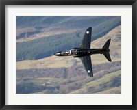 Framed Hawk T1 trainer aircraft of the Royal Air Force low flying over North Wales