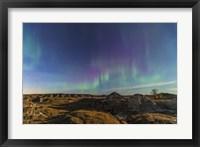 Framed Aurora borealis over the badlands of Dinosaur Provincial Park, Canada
