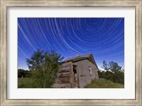 Framed Circumpolar star trails above an old farmhouse in Alberta, Canada