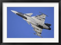 Framed Hungarian Air Force Saab JAS-39C Gripen fighter plane