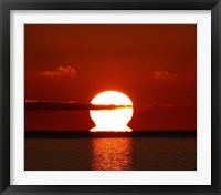 Framed omega-shaped sunrise above the water in Buenos Aires, Argentina