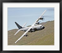 Framed C-130J Super Hercules low flying over North Wales on a training flight