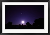 Framed bolide from the Geminids meteor shower above a setting moon in Mercedes, Argentina