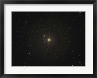 Framed red giant star Beta Andromedae and its ghost galaxy NGC 404