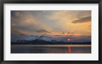 Framed Midnight Sun over Tjeldsundet strait in Troms County, Norway